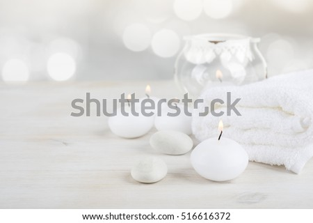 Spa resort therapy composition. Burning candles, stones, towel, abstract lights #516616372
