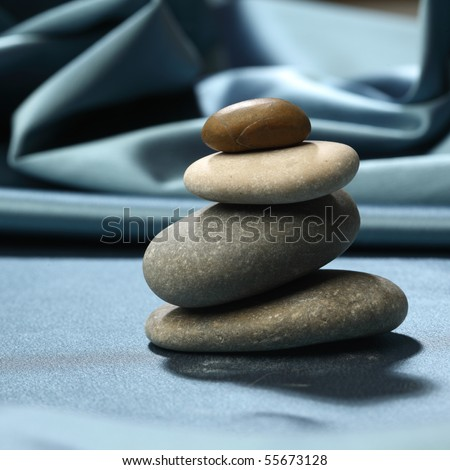 spa rock on ripled background
