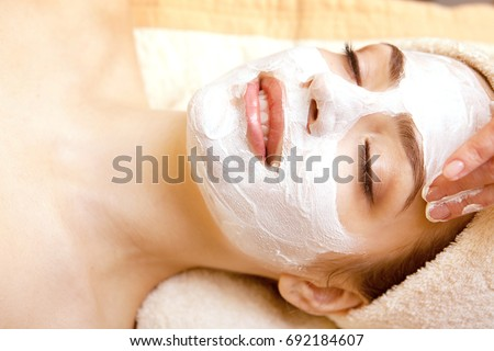 Spa salon: Beautiful Young Woman having Facial Treatment in Spa salon