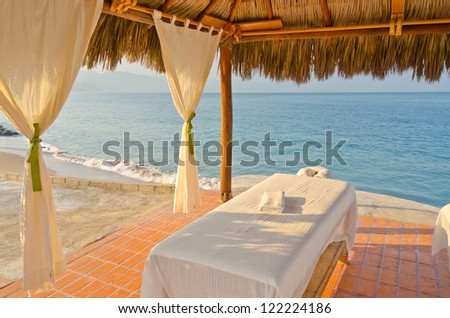 Stock Photo Spa salon on beach of tropical island - healthcare background