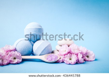 Spa salt, stones and bath bomb, flower branch for beauty and health. Healthy relaxation, therapy and treatment. Aromatherapy, body care, aroma massage. Alternative lifestyle.  #436445788