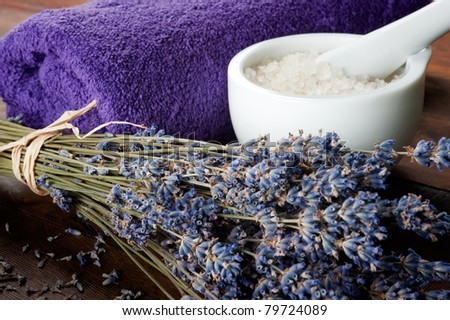 Spa set with lavender, towel and sea salt. Shallow DOF, focus on lavender - stock photo