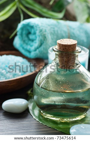 Spa setting with bath salt and floral water