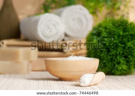 Spa setting with bath salt and towel.
