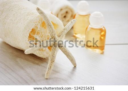 Spa setting with beauty products, shampoo and bath salt