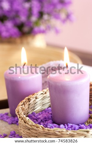 Spa setting with candle and towel