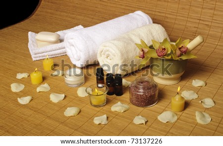 Spa setting with candles and rose petals