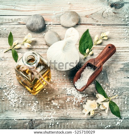 Spa setting with jasmine essential oil and flowers. Wellness concept, top view #525710029