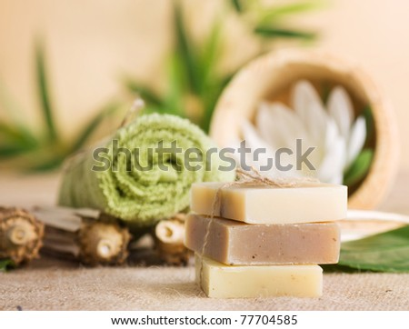 Spa setting with natural soaps and lotus flower.