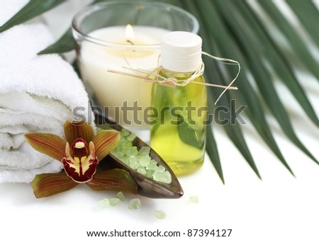 Spa setting with orchid, burning candles and salt