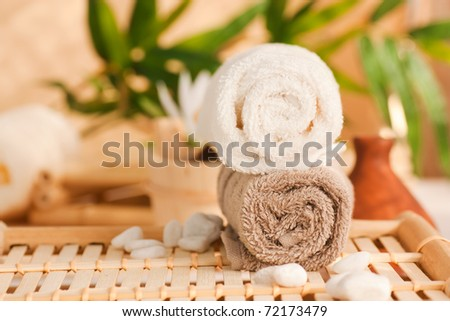 Spa setting with two towels and pebbles