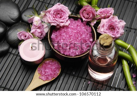 spa settings �pink rose with salt in bowl and candle with bamboo grove on mat