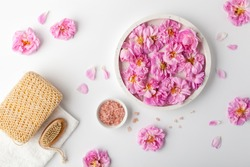 Spa settings with roses. Fresh damask roses and rose petals and various items used in spa treatments.