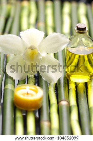 Spa sitting with orchid and massage oil with candle