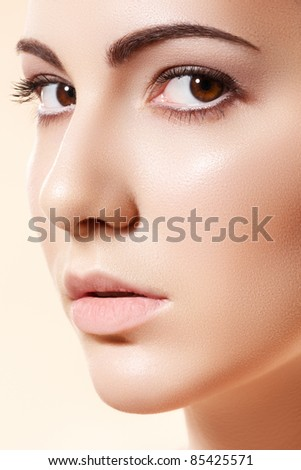 Spa, skincare, wellness & health. Close-up portrait of beautiful female model face with purity health skin & light make-up on bright beige background