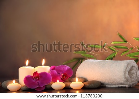 Spa Still life with aromatic candle orchid flower and towel