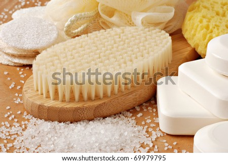 Spa still life with bamboo bath brush and natural vegetable oil soap.  Macro with shallow dof.