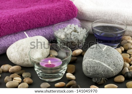 spa still life with bath towels, candles and salt crystals