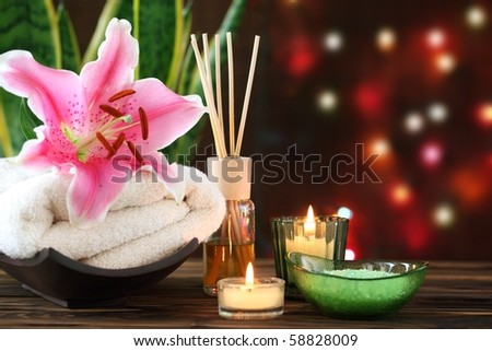 Spa still life with essential oil,candles and towel