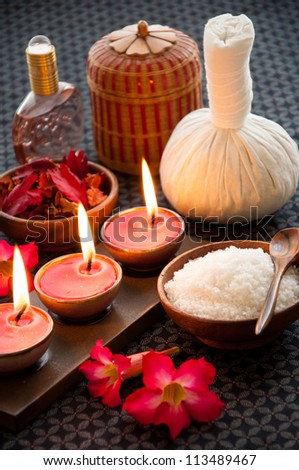 Spa still life with exfoliation salt scrub and spa accessories.