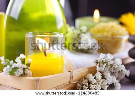 Spa  still life  with flower  and candles on dark and unfocused  background