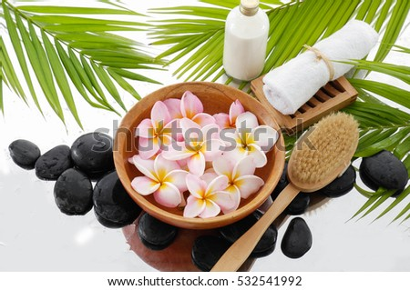 spa still life with frangipani with towel and fern leaf ,candle on towel