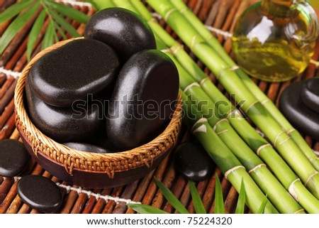 Spa still life with hot stones and essential oil