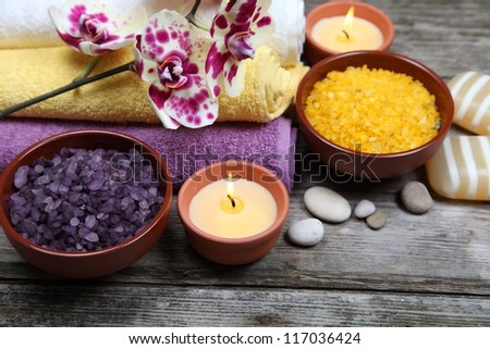 Spa still life with orchid on a wooden background