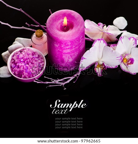 Spa still life with pink candle and orchids