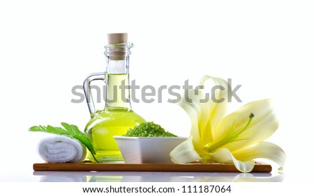 spa still-life with spa oil, sea salt and flower isolated on white