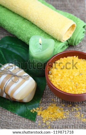 Spa still life with towels and soap on a wooden table - stock photo