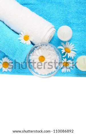 Spa still life with towels, flowers and salt