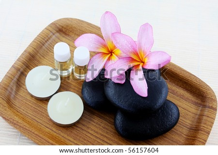 spa stone and frangipani flower in the tray