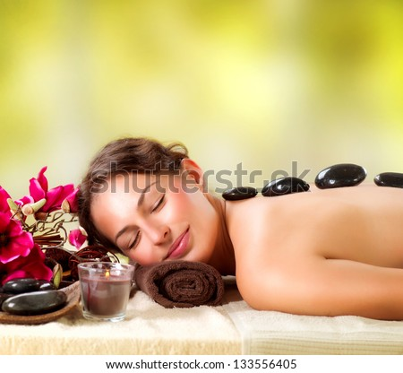 Spa Stone Massage Beautiful Woman Getting Spa Hot Stones Massage in Spa Salon Beauty Treatments Outdoor Nature