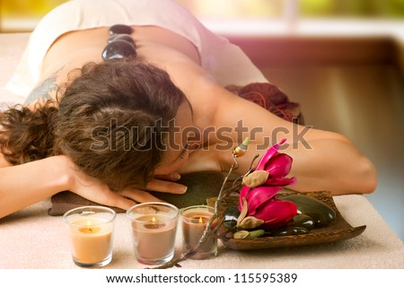 Spa Stone Massage. Day-Spa Treatment. Beautiful Woman in Spa Salon.