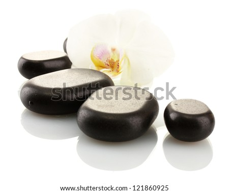 Spa stones and orchid flower, isolated on white