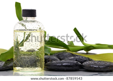 spa stones and scented oil bottle