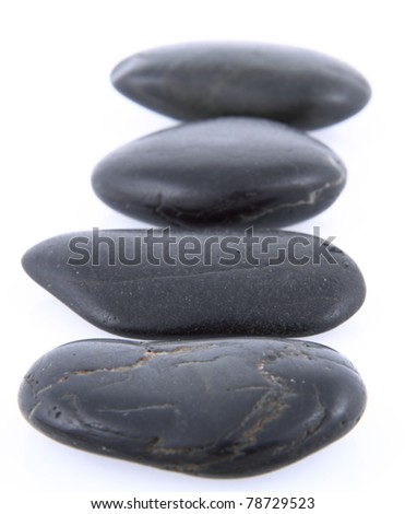 Spa stones on a white background