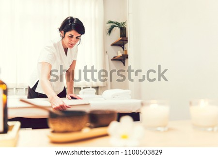 Spa therapist preparing for next client