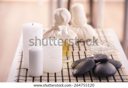 Spa therapy. Spa concept. Zen basalt stones, spa oil, spa herbal balls and sea salt.