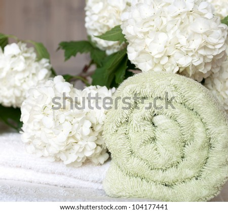 Spa towels and white flowers