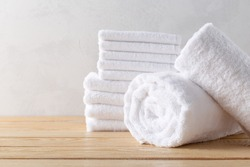 spa towels on wooden surface