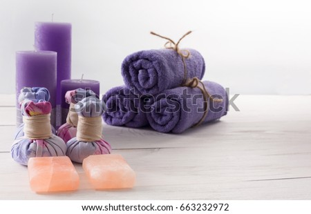 Spa treatment and aromatherapy concept background. Soap, aroma salt, herbal balls for indian spa, candles, details and accessories for wellness beauty parlor. White wood with copy space #663232972