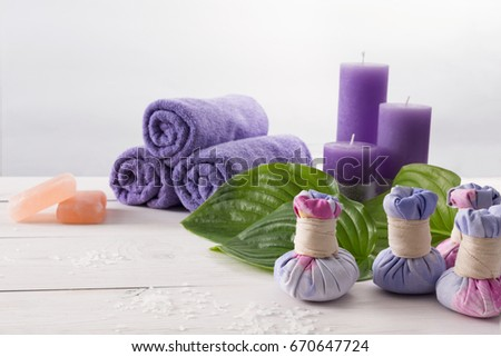 Spa treatment and aromatherapy concept background. Soap, aroma salt, herbal balls for indian spa, candles, details and accessories for wellness beauty parlor. White wood with copy space #670647724