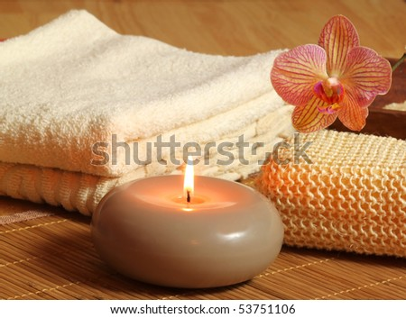 Spa treatment for beauty and relax. Candle and orchid flower