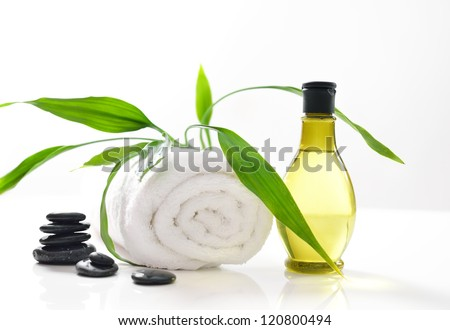 Spa treatment with towels and green bamboo