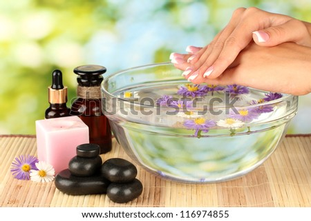 spa treatments for female hands,  on bright green background