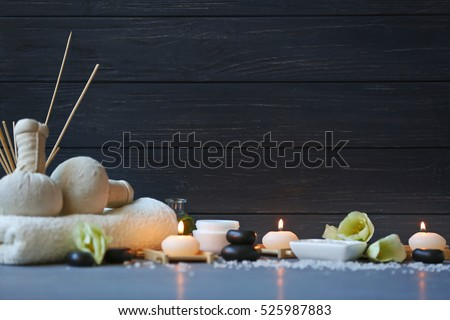 Spa treatments on blue wooden table #525987883