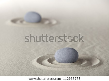 spa wellness background with round stones and sand like in Japanese zen garden for meditation and relaxation to find spiritual balance and purity