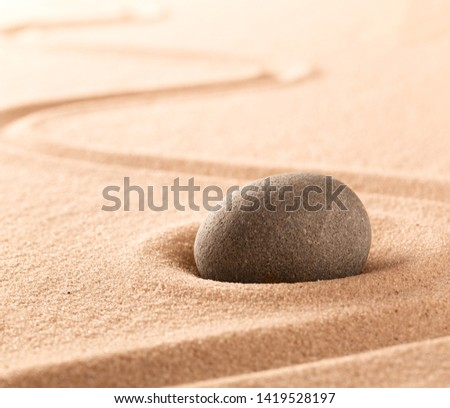 Spa wellness or mindfulness stone and sand garden. Concentration or focus point for spiritual balance and purity of mind and soul. Sandy background with copy space.  #1419528197